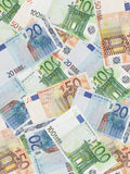 Euro background. Background of twenty, fifty and one hundred euro banknotes Stock Photos