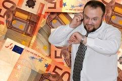 Euro background. Businessman speaking by phone on euro background Royalty Free Stock Photo