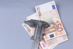 Euro background and a caliper. Euro banknotes and a caliper Royalty Free Stock Photo