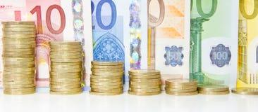 Euro background. Coins and bank notes Stock Photos