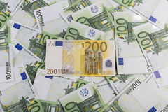 100 euro background with 200 euro on top. Banknotes of 100 euro background and 200 euro on top Royalty Free Stock Image