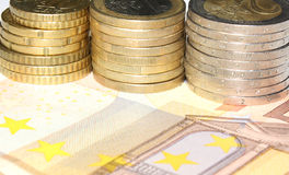 Euro background. A background made with euro coins and a 50 euro bill Royalty Free Stock Images