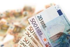 Euro banconota su una priorità bassa blured di soldi Fotografie Stock