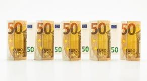 50 euro banconote acciambellate nelle file Isolato su una priorità bassa bianca Fotografie Stock Libere da Diritti