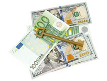 Euro banconote, dollari e chiave Fotografia Stock