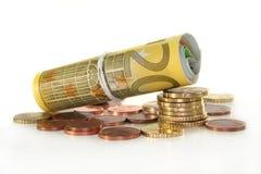 Euro banconote e monete Fotografie Stock Libere da Diritti