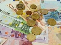 Euro banconote e monete Fotografia Stock Libera da Diritti