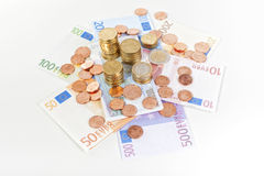 Euro banconote e monete fotografie stock