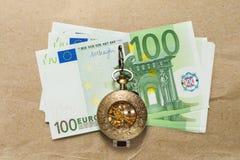 Euro banconote e orologio da tasca d'annata Fotografia Stock Libera da Diritti