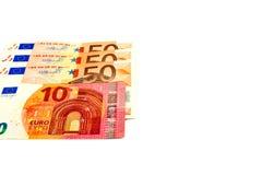 Euro banconote isolate su un fondo bianco con lo spazio della copia per testo Immagini Stock