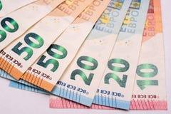 Euro banconote su Libro Bianco Fotografia Stock Libera da Diritti