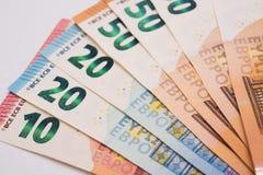 Euro banconote su Libro Bianco Fotografie Stock Libere da Diritti