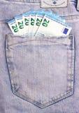 Euro banconote in tasca grigio scuro dei jeans Fotografie Stock