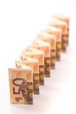 50 euro banconote in una linea Immagini Stock