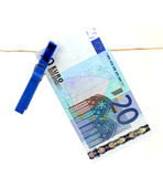 20 Euro bank note hanging on clothesline Stock Photography