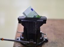 Euro bank note in vise. Economic and financial crisis.  stock photos