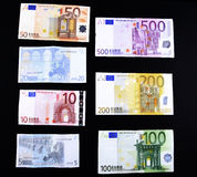 Euro bank notes. Isolated different euro bank notes on black background Royalty Free Stock Image