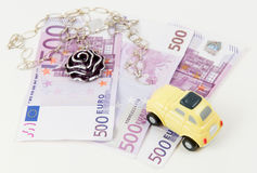 500 Euro bank notes, car and jewelry Royalty Free Stock Photography