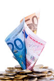 Euro bank notes and coins Stock Images
