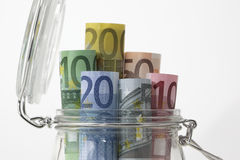Euro bank notes in a glass jar Stock Photo