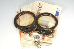 Euro bank notes and handcuffs Royalty Free Stock Photos