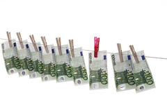 100 Euro bank notes hanging on clothesline Royalty Free Stock Photography
