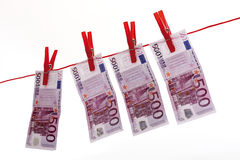 500 Euro bank notes hanging on clothesline Stock Photos
