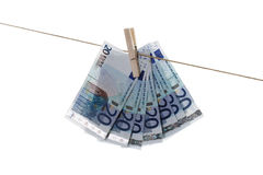 20 Euro bank notes hanging on clothesline Stock Image