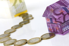 Euro bank notes House and coins Royalty Free Stock Images