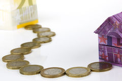 Euro bank notes House and coins Stock Photo