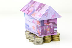 Euro bank notes House and coins Royalty Free Stock Photos
