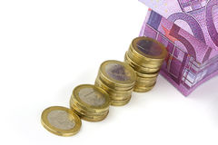 Euro bank notes House and coins Stock Image