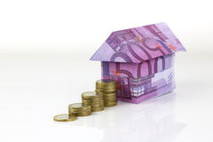 Euro bank notes House and coins Stock Photography