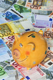 Euro Bank notes with a piggy bank illustrating success Royalty Free Stock Images