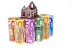 Euro bank notes with shell house Stock Photo