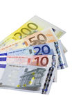 Euro bank notes widespread. In front of white background Royalty Free Stock Image