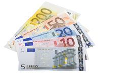 Euro bank notes widespread. Euro banknotes widespread in front of white background Royalty Free Stock Images