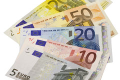 Euro bank notes widespread. Euro banknotes widespread in front of white background Royalty Free Stock Photo