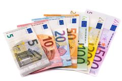 Euro bankbiljetten die op witte achtergrond worden geïsoleerda Stock Afbeeldingen