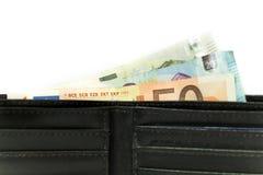 Euro bankbiljetten en muntstukken Geld in de portefeuille Economie in Europa royalty-vrije stock foto's