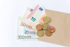Euro bankbiljetten en muntstukken op witte achtergrond royalty-vrije stock fotografie
