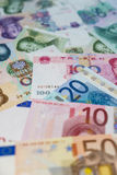Euro bankbiljetten en Yuan Stock Fotografie