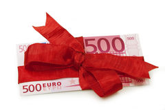Euro banknote as gift. Fivehundred Euro banknote wrapped with red ribbon as a gift Stock Photos
