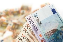 Euro banknote on a blured background of money. Twenty, five hundred and fifty euro banknote on background of money Stock Photos