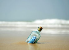 20 euro banknote in a bottle found on the shore of the beach Royalty Free Stock Photos
