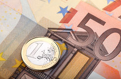 Euro banknote and coin Stock Photos