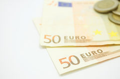 Euro banknote with coins Stock Photography
