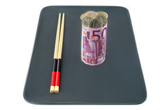 Euro banknote in the form of sushi stuffed with co Royalty Free Stock Photos