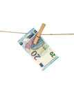 20 Euro banknote hanging on clothesline on white background. Stock Images