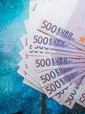 500 euro banknote isolated on blue background, finance concept. cash, close up. 500 euro banknote isolated on blue background, finance concept. cash royalty free stock photography